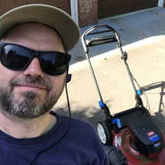 Kirk Johnson '95 and his Lawn mowing