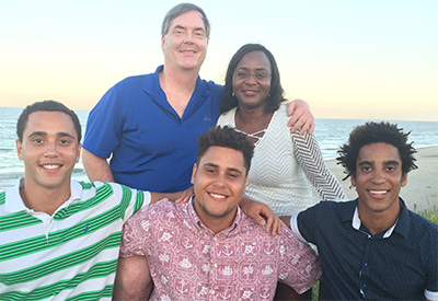 Christina Cutlip '83, back right, poses with her husband and three children.