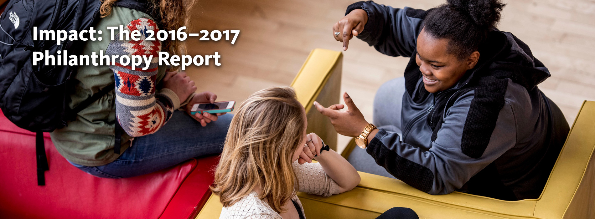 Infographic: Impact - The 2016-2017 Philanthropy Report. Image: Students chatting while sitting in colorful armchairs.