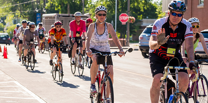 Reunion attendees ride through the streets of Grinnell.