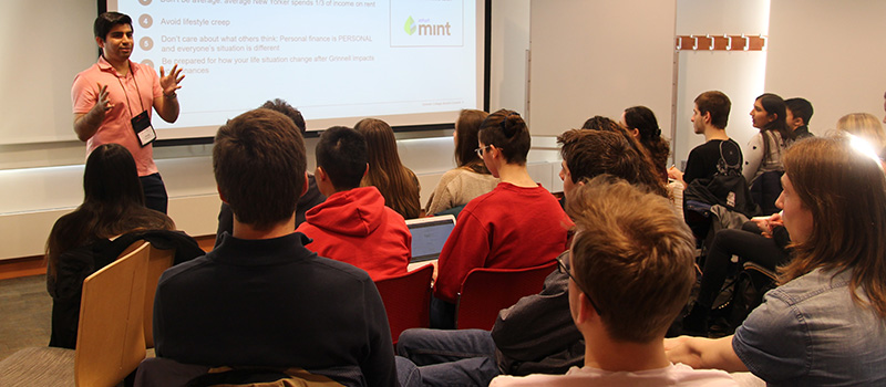 Ahsan Rahim '11 gives students advice about budgeting during a personal finance workshop on March 6.