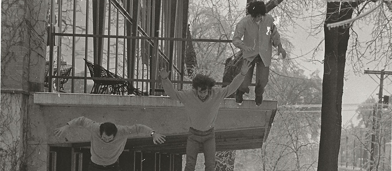In a photo from their student days, Andy Loewi '71, left, John Otto '71, and Ed Hirsch '72 leap from the Burling Library deck.