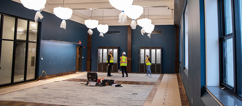 A new space for faculty and staff features dark blue walls and classic lighting fixtures.