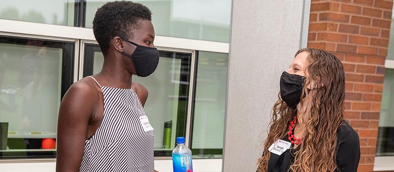 Christine Ajinjeru '14, left, and Sarah Burrell '14