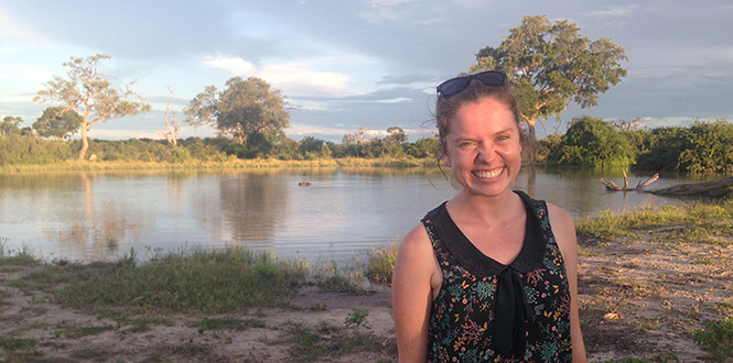 Hannah Lundberg '18 in Botswana with a hippo in the background in a lagoon
