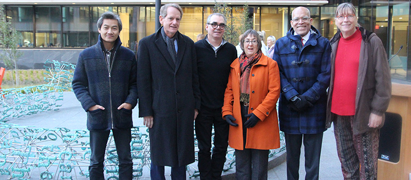 Hai-Dang Phan '03, left, John Chambers '77, Gregory Gómez '80, Lesley Wright, Raynard S. Kington, and Bobbie McKibbin spoke during a ceremony to dedicate the Broken English sculpture.