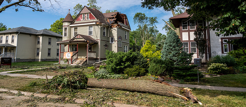 The roof of the Chinese House on Park Street was hit by a fallen tree during the derecho on Aug. 10. The storm cause roof damage to about 80 structures owned by the College.