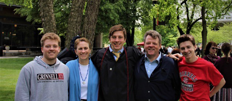 The Dixon-Anderson family  –  Erik '14, left, Lynn '84, Ian '17, Gene '83, and Kyle '21 – stand for a group shot during Ian's graduation in 2017.