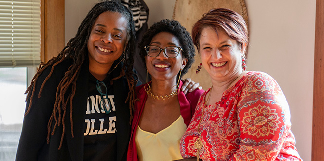Stephanie Jones, left, an assistant professor of education, Rayyon Robinson '19, and Maure Smith-Benanti, associate dean of students and director of intercultural affairs, during the dedication of the new library to Edith Renfrow Smith '37.