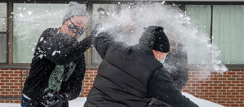 Conor Martin '24 took a break from moving into Norris Hall on Jan. 24 to engage in a snowball fight with his parents, David Martin and Wendy Magis.