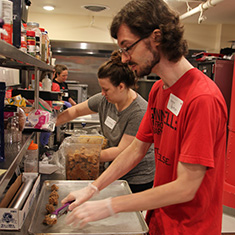 Aaron Barker '11 prepares cookies at the Iowa Homeless Youth Center