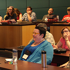 An Alumnae listens to a presentation while back on campus for reunion.