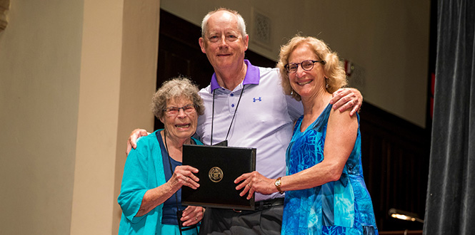 Hester Newton '49 (left) and Claudia Beckwith '77 present Carter Newton '77 with an alumni award at Reunion 2018.