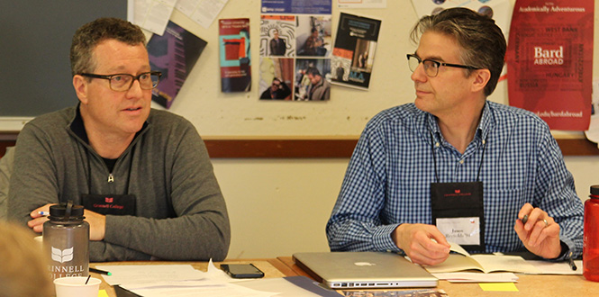 Jason Reynolds '94, right, listens to a comment made by Steve MacFarlane '82, Puget Sound regional coordinator, during a regional network volunteers meeting Saturday in Grinnell.