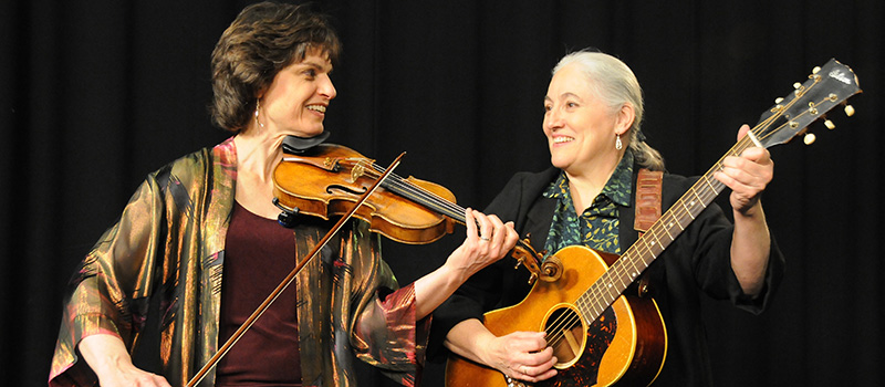 In the band Simple Gifts, Karen Smith Hirshon '73 (right) preforms with Linda Littleton.