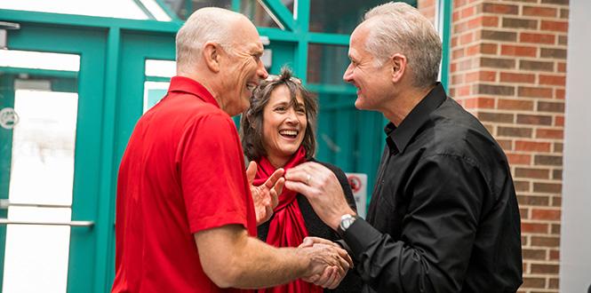 John Kispert '85 and Jill Goldberg Kispert chatting with Basketball Coach Dave Arseneault, Sr.