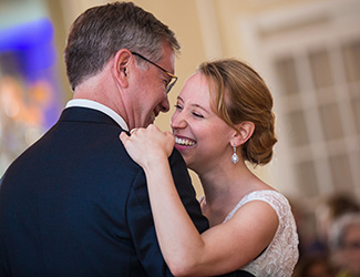 Scott McMurray '79 dancing with daughter Julia '08, at Julia's wedding