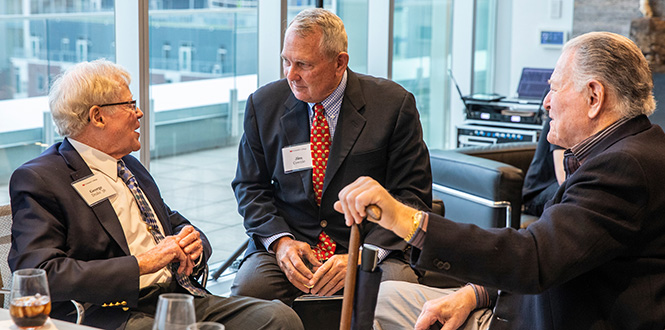 Drake talks with Jim Cownie, center, a Des Moines developer who brought up the idea for the Rosenfield book, and Bill Friedman, a former CEO of Younkers who helped Drake with biographical research.
