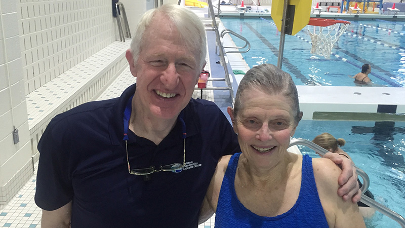 Mike Daley '72 is pictured with a swimmer at the Holland Community Aquatics Center in Michigan. Daley is a master's swim coach at the center.