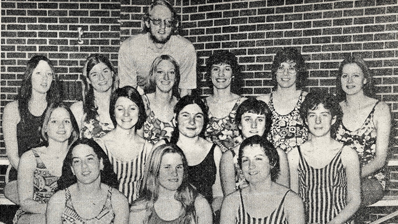 A newspaper from 1975 shows members of the women's swimming team. Daley served as the coach for three seasons.