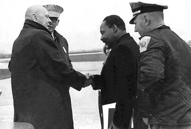 Martin Luther King Jr. arriving at the Grinnell Airport