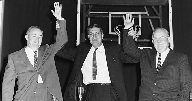 Hubert Humphrey, left, Clark Mollenhoff, and Homer Capehart visited the College in November 1961 for a PPPE event.