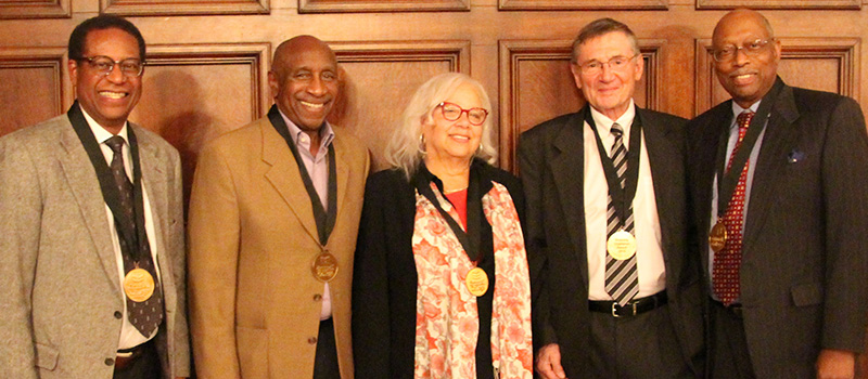 Hubert Farbes '69, left, Roy Walker '69, Merryll Penson '70, Grant Crandall '69, and Henry Wingate '69 received the  2019 Diversity Champion Award for their efforts as students to start Concerned Black Students and the Black Cultural Center.