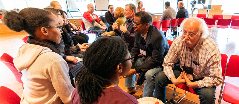 Multicultural Alumni Weekend attendees exchange stories during the Looking Back and Leaping Forward workshop on Friday.