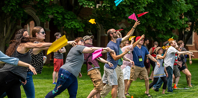 Reunion attendees ascend their handcrafted paper airplanes during Relays 2.0 Friday at Mac Field.