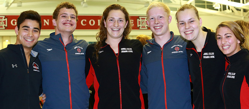 Mitch Sevier '21, second from left; and Paul Cover fourth from left, are pictured with their Grinnell College swimming teammates at the 2018 Midwest Conference meet.