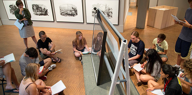 Grinnell students take notes for an art project at the Faulconer Gallery.