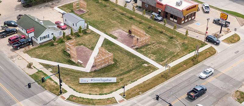 An aerial view taken from a drone shows how the Grinnell Crossroads sculpture fits into the intersection around Sixth Avenue and West Street.