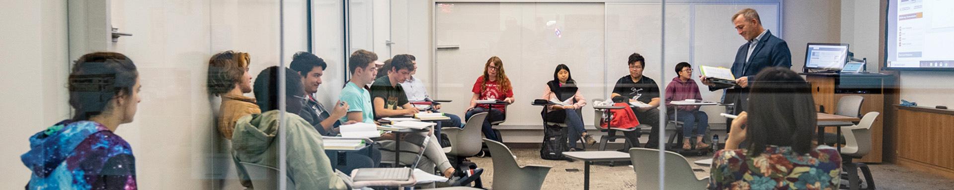 Dan Reynolds, Seth Richards professor in modern languages, leads a German class in the HSSC.