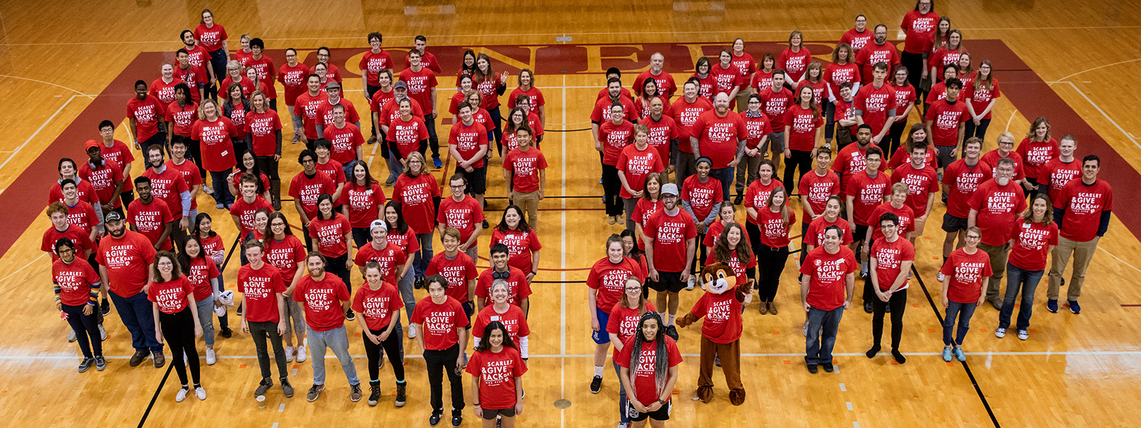 Approximately 200 students, faculty, and staff joined in creating a Human Laurel Leaf at Darby Gym in celebration of the fifth annual Scarlet & Give Back Day.