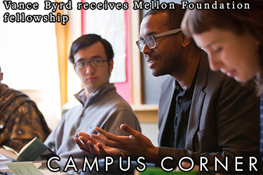 Text: Vance Byrd receives Mellon Foundation fellowship. Image: Professor Vance Byrd speaking with students.