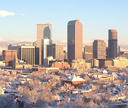 Denver Skyline taken in Winter with the Rocky Mountains in the background.