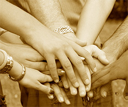 Hands reached into a huddle