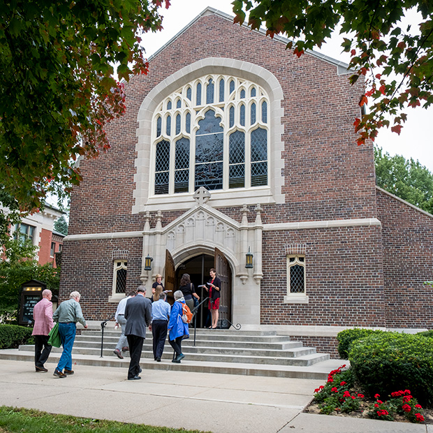 Faculty, Staff, and Students enter Herrick Chapel.