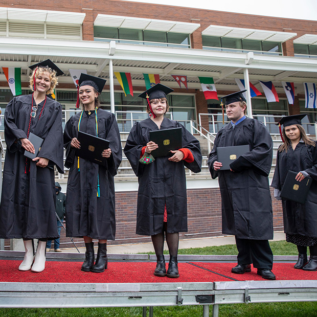 Seniors prepare to walk across the stage at Commencement 2021.