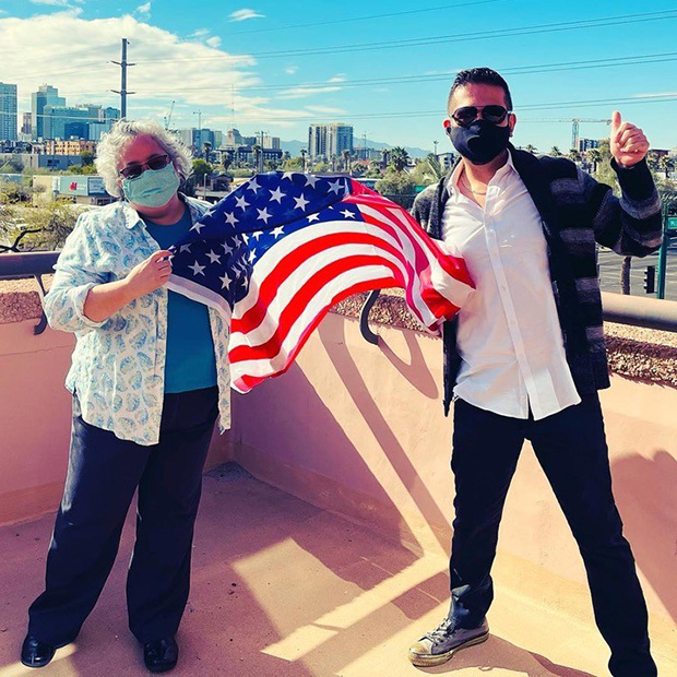 Jillian Kong-Sivert '91, left, and a client celebrate a big legal victory on the balcony of her office in the Phoenix area.