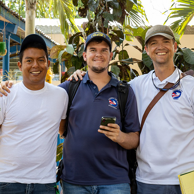 Mansir Petrie '99, right, is pictured with two Peace Corps colleagues in Panama. Petrie served as a Peace Corps Response program manager.