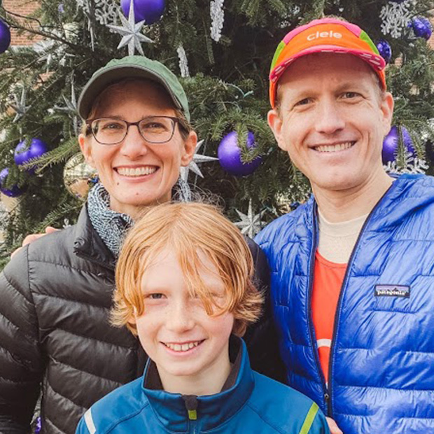 Neil Martin '99 (right), with his wife Jenn (Larimer) Martin '99 and their son.