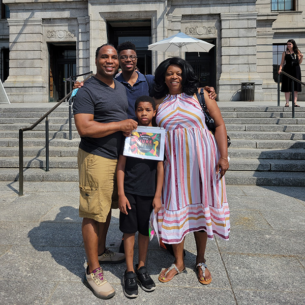 Fredrick Mann '97 and his family stand for a photo outside the Boston Museum of Fine Arts during the Juneteenth celebration on June 19.