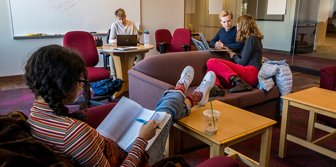 Students do homework and collaborate on an assignment in one of the many study spaces inside the HSSC.