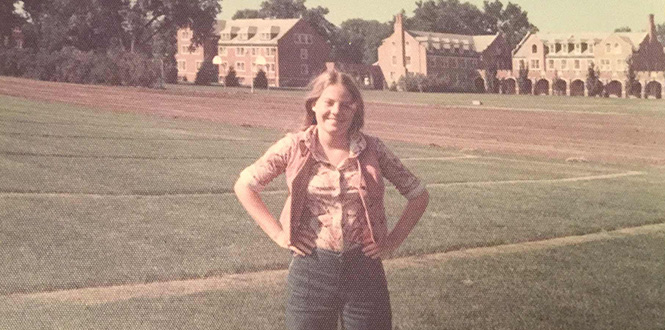 Mary Hartnett '80 poses for a photo on campus in summer 1976 before her first year at Grinnell.