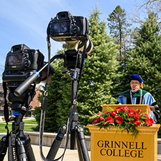 Raynard Kington, president of Grinnell College, presents during virtual commencement with cameras in the foreground.